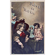 French Tinted Real Photo Postcard, Cute Schoolgirl with 6 Dolls, Christmas Dream, Circa Early 1900s