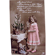 Tinted Real Photo Postcard, Gorgeous Little Girl, Bisque Dolls and Christmas Tree, Printed in Germany for the English Market, Circa 1910s