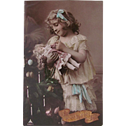 Merry Christmas, Tinted French Real Photo Postcard,  Pretty Little Girl, Bisque Doll and Christmas Tree, Postmarked 1908