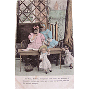 Hand-colored French Real Photo Postcard, 2 Little Girls and 2 Pretty Dolls, Postmarked 1904