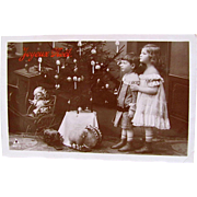 French Christmas Card, 2 Children, Doll, Toys and Decorated Tree, Real Photo Postcard, Circa 1910s