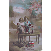 Hand Tinted French Real Photo Postcard, 2 Beautiful Children, Military Dolls and Toys, Happy New Year, Circa 1910s