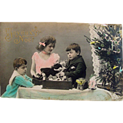 French Tinted Real Photo Postcard, 3 Children, Doll, Toys and Christmas Tree, Circa Early 1900s