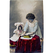 Tinted Real Photo Postcard, Teaching Dolly To Read, Little Girl With Big Bisque Doll and Book