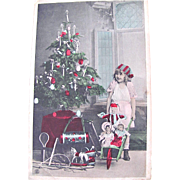 Little Girl, Wheelbarrow, Dolls, Toys and Christmas Tree, Tinted French Real Photo Postcard, Circa 1910s