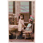 French Tinted Real Photo Postcard, Little Girl Holding Her Doll's Hand, Happy Anniversary, Circa 1910s