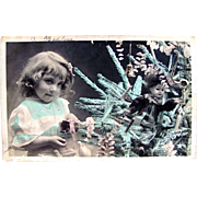 Tinted French Real Photo Christmas Postcard, Little Girl, Doll and Decorated Tree, Postmarked 1904