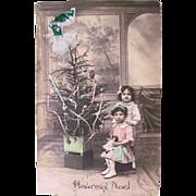 Hand Tinted French Real Photo Postcard, Boy, Girl, Doll and Christmas Tree, Circa 1910s