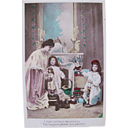 Christmas Card, Mother, 2 Children, Doll and Toys, French Tinted Real Photo Postcard Circa 1910s