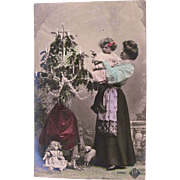 Tinted French Real Photo Christmas Postcard, Mother and Daughter, Dolls, Toys and Decorated Tree, Postmarked 1906