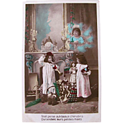 French Tinted Real Photo Postcard Circa 1910s, 2 Children, Cherub, Dolls and Toys, Christmas Morning