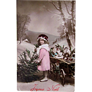 Tinted French Real Photo Postcard, Little Girl, Christmas Tree and Cartful of Dolls and Toys, Circa 1910s