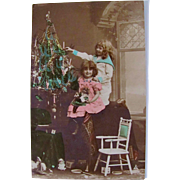 Tinted French Real Photo Postcard, Christmas Tree, Dolls, Toys and Children, Postmarked 1903