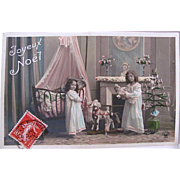 French Tinted Real Photo Postcard, Christmas Morning, 2 Girls, Dolls, Toys and Decorated Tree, Circa Early 1900s