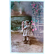 Tinted French Real Photo Postcard, Small Girl, Doll and Pink Roses, Circa 1910s