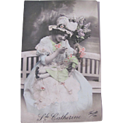Tinted French RPPC, Lady and Bisque Doll in Bonnets, St. Catherine, Vintage 1910s, Real Photo Post Card