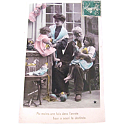 French Tinted Real Photo Postcard, Mother, Grandfather, Children, Dolls, Toys, Christmas 1907