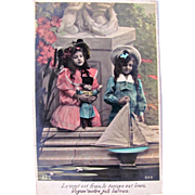 French Tinted Real Photo Postcard, Girl, Doll, Boy and Boat, Circa 1910s