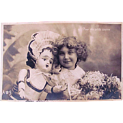French Real Photo Postcard, Little Girl and Big Doll, Postmarked 1904