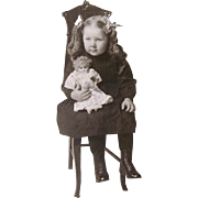 Original Photograph, Little Girl and Bisque-head Baby Doll, c. 1900s