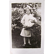 Real Photo Postcard, Little Girl and Bisque-head Dolly In a Garden, Postmarked 1914