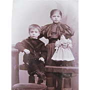 Antique Photograph, Cabinet Card, Little Boy and Girl Holding Bisque-head Doll, ca. 1890s