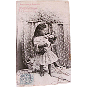 Sepia French Real Photo Postcard, Little Girl Holding Doll, Souvenirs de Jeunesse, Postmarked 1908