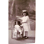 Vintage French Real Photo Postcard, Little Girl with Big Doll, Early 1920s