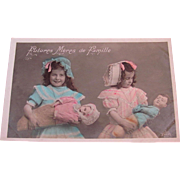 Two Little Girls With Baby Dolls, Hand Tinted Antique French Real Photo Postcard, Circa 1910s