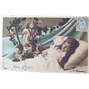 French Bisque Doll and Sleeping Child, A Child's Dream, Hand Tinted French RPPC, Postmarked 1905