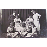 Real Photo Postcard, 7 Playmates and Big Baby Doll, St. Paul, Minnesota, Circa Early 1900s