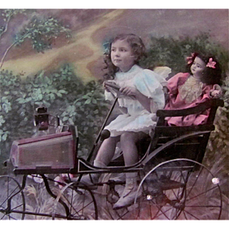 French Tinted Real Photo Post Card, Gage d' Affection, Little Girl and Bisque Doll in Pedal Car, Circa 1910
