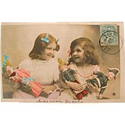 Two Little Sisters, Three Dolls, French Real Photo Postcard, Hand Tinted, Postmarked 1905