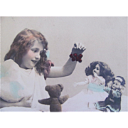 French Hand Tinted Real Photo Postcard, Little Girl, Dolls and Teddy Bear, Dated 1911