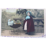 The Little Nanny, Tinted French RPPC, Bisque Baby Doll, Doll Pram and Little Girl, Dated 1906