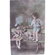 French Real Photo Postcard, Hand Tinted, Girl, Boy, Doll and Dog, Postmarked 1913