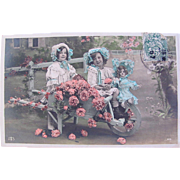 Hand Tinted French Real Photo Postcard, Girls, Doll and Roses, Postmarked 1907