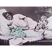 Spanish Real Photo Postcard, Hand Tinted, Sleeping Child, Dolls and Doll Clothes, Circa Early 1900s