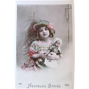 French Real Photo Postcard, Hand Tinted, Happy New Year, Little Girl with Doll, Circa 1910s