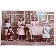 Heureuse Année, Tinted French Real Photo Postcard, Little Girls and Boys, Dolls, Harlequin and Tea Set, Postmarked 1910