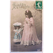 Bonne Année, Tinted French Real Photo Postcard, Little Girl with French Fashion Doll, Postmarked 1909