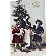 c1912 Tinted RPPC, Boy, Girls, Doll, Horn, Violin, Toys, Decorated Christmas Tree, Real Photo Postcard, Heureux Noel