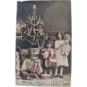 Circa 1908 Tinted French RPPC, Girl With Doll, Boy With Drum, Additional Toys, Decorated Christmas Tree, Real Photo Postcard, Postmarked