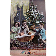 Tinted Real Photo Postcard, Danish Christmas, Little Girl and Boys, Doll in Carriage, Toys and Decorated Christmas Tree, Vintage 1910s