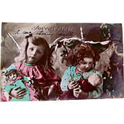 Hand Tinted French Real Photo Postcard, 2 Winged Cherubs, Dolls and Toys, Joyeux Noël, Postmarked 1905
