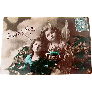 Tinted French Real Photo Postcard, 2 Little Angels, Doll and Pine Boughs, Joyeux Noël, Postmarked 1908