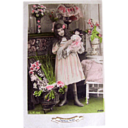 French Hand Tinted Real Photo Postcard, Little Girl and Doll Wearing Matching Dresses, Joyeux Noel, Postmarked 1908