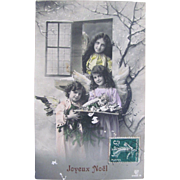 Hand Tinted French Real Photo Postcard, 3 Christmas Angels, Doll and Toys, Joyeux Noël, Postmarked 1911