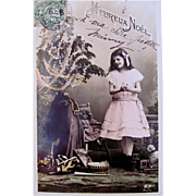 French Tinted RPPC, Heureux Noel, Decorated Christmas Tree, Little Girl, Doll, Drum, Horn, Book, Vintage 1900, Marked M.F. Paris, Divided Back with Written Message