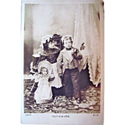 French RPPC, Tout A la Joie, Little Girl with French Fashion Doll, Little Boy with Pipe, Unused, Circa Early 1900s
